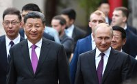 Xi, Putin vow efforts to advance relations with North Korea