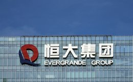 Key Evergrande deal to sell stake in unit put on hold - sources