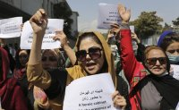 Afghan women demand rights as Taliban seek recognition