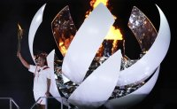 Troubled by pandemic, Tokyo Games open with scaled-back ceremony
