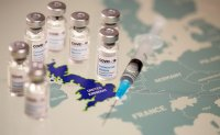 WHO warns virus crisis not over as vaccine rollout starts