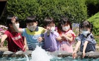 As weather heats up, worries grow over wearing face masks