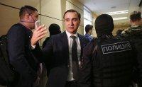 Russian court arrests top Navalny's associate in absentia