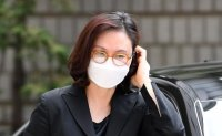 Prosecution seeks 7-year prison term for ex-justice minister's wife at appellate trial