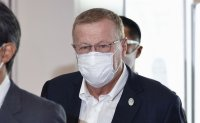 Olympics organizers to unveil pandemic 'playbook' as IOC vice president arrives in Tokyo