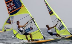 Surfing medals to be decided early, softball in focus as storm churns off Japan