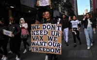 Thousands protest lockdown in Sydney