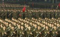 North Korea holds midnight military parade