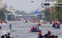 Foreign journalists harassed covering China floods: correspondents' club