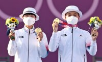 Korea wins gold in archery's mixed team Olympic debut