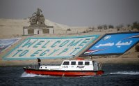 Stuck ship in Egypt's Suez Canal imperils shipping worldwide