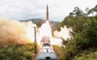 North Korea confirms missile launches from train