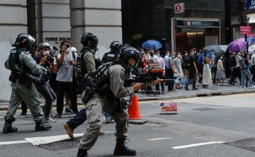 Fifteen arrested but most Hong Kong protesters stay home