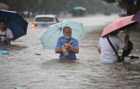 Flooding in central China turns streets to rivers, killing at least 12