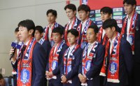 World Cup team returns to warm welcome