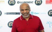 Tyson, 54, to return for exhibition match against Jones Jr.